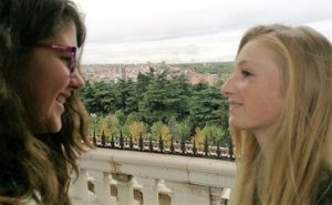 Immersion: One Spanish student looking at her friend coming for a Spanish inmersion in Madrid